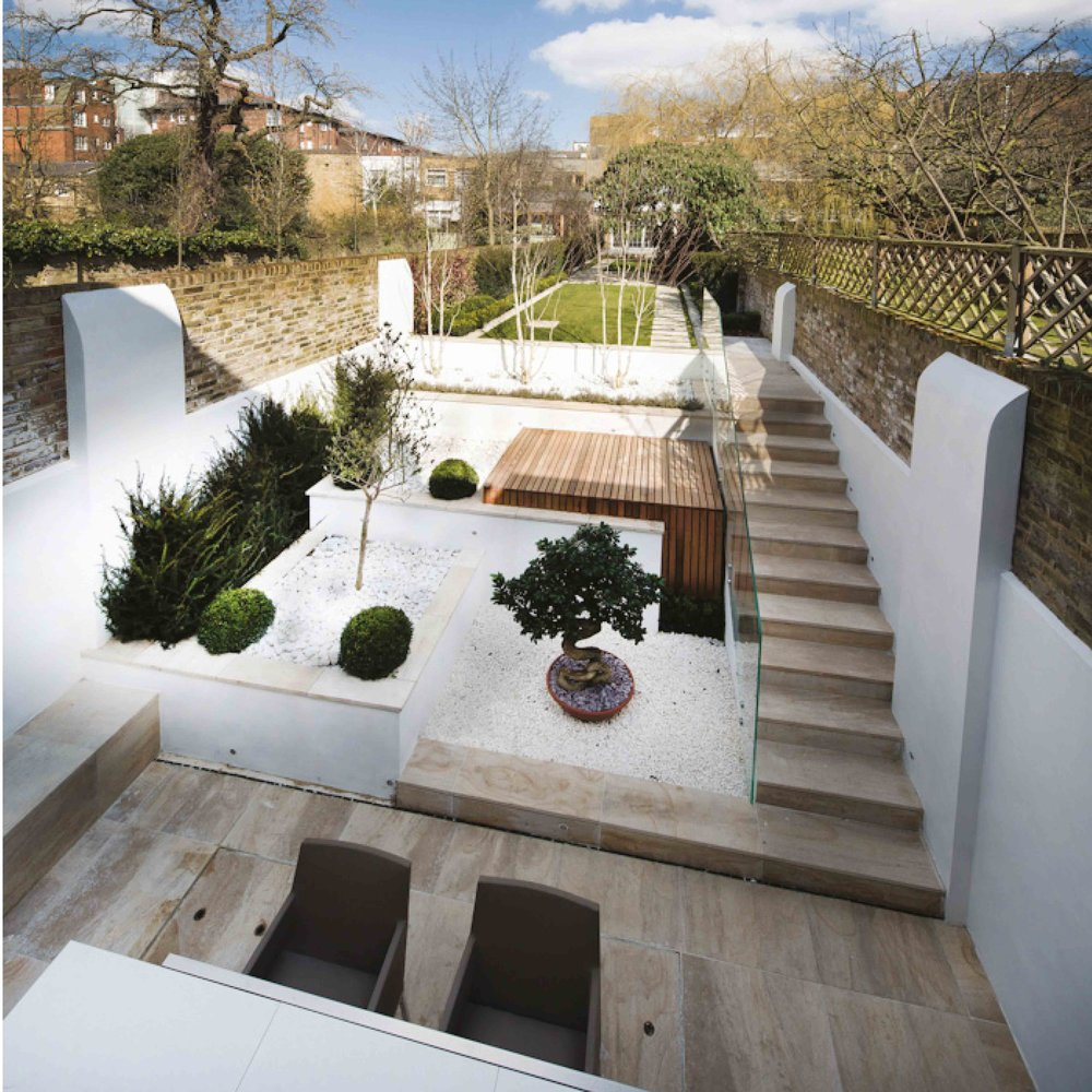 The extension landscaped the green to create an outdoor seating area with an eastern inspired terraced rock garden before learning into the original grass lawn garden.