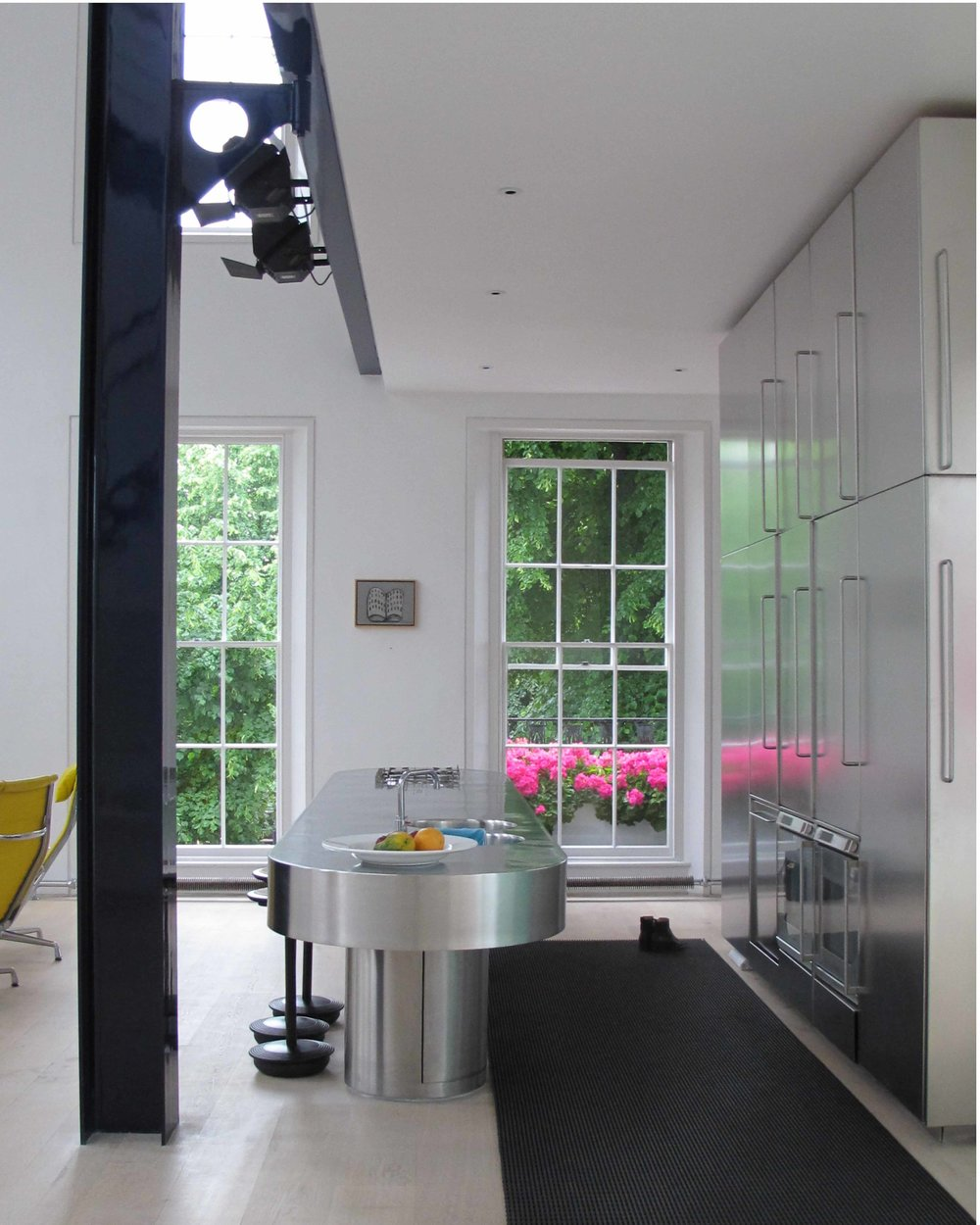 The kitchen. Polished stainless steel, dinesen floor boards. Georgian terrace house refurbishment.