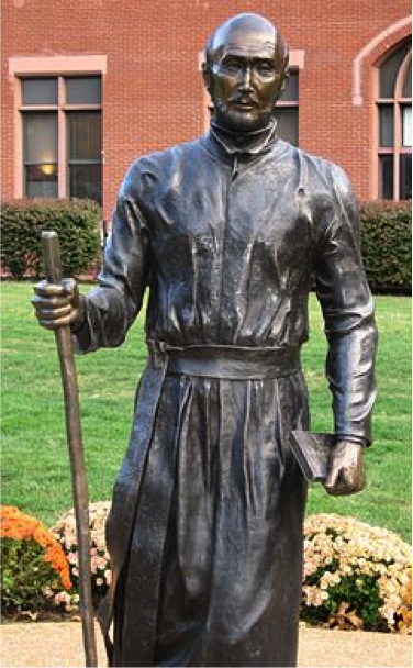 Here is a statue of St. Ignatius, one of the founders of  the Jesuit Catholic Order. This statue is located in the quad in front of DeBourg Hall, the administrative building.
