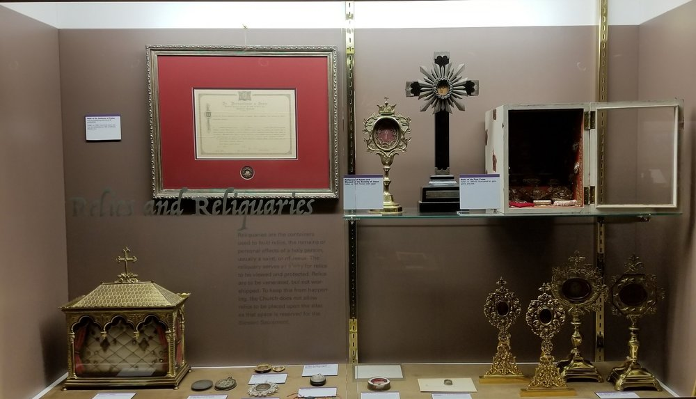 Museum case of relics and reliquaries. Jesuit collection. Saint Louis University Museum of Art. Photo by authors.