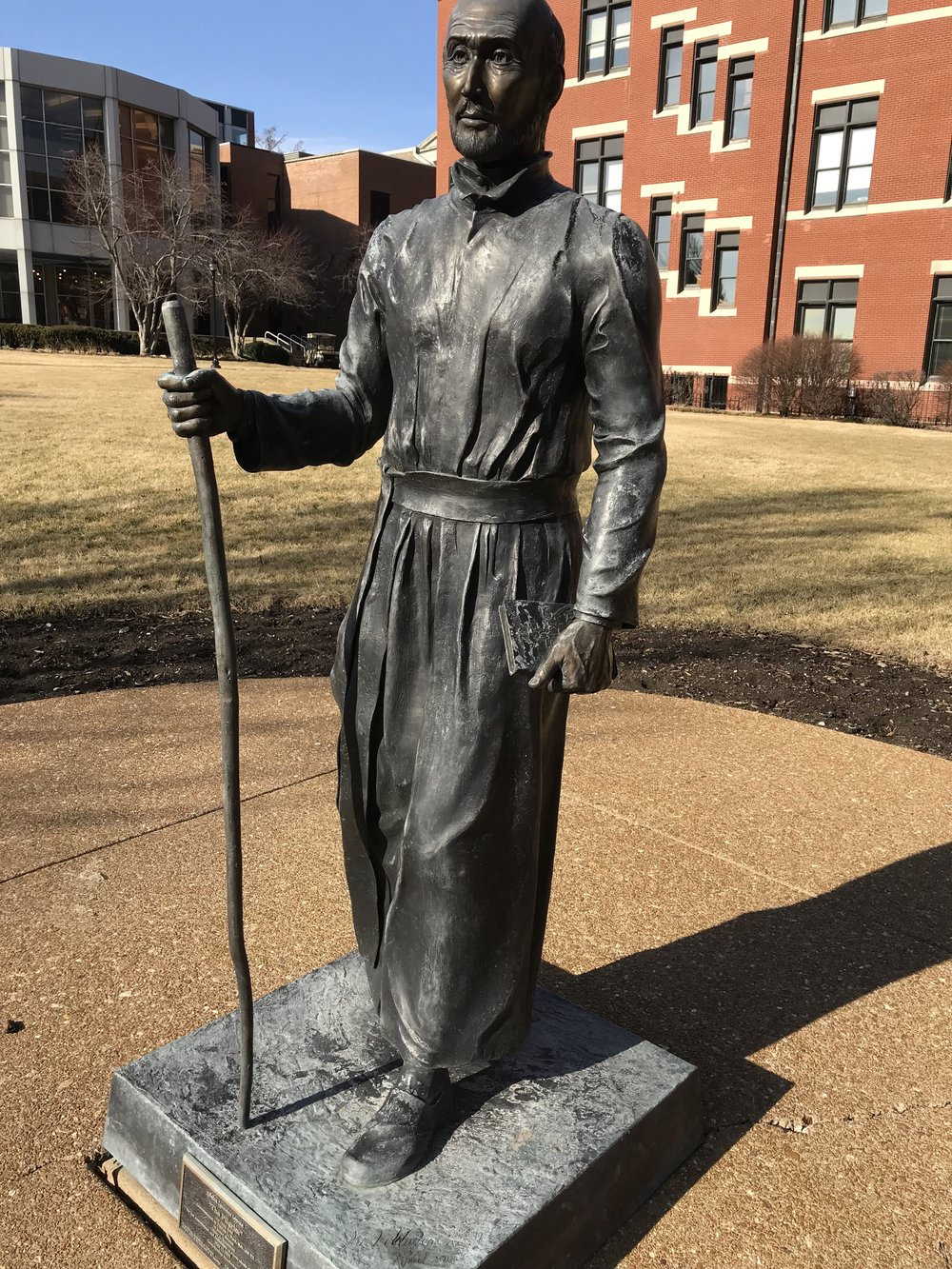 Statue of St. Ignatius of Loyola in front of DuBourg Hall, Saint Louis University. Photo by Rachel Lindsey.