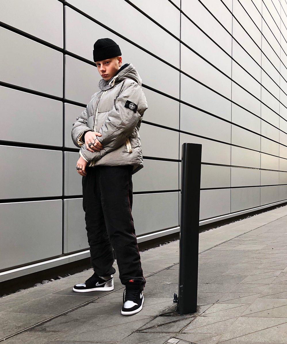@GullyGuyLeo  seen wearing  Aleali May x Air Jordan 1 Retro High OG and Stone ISLAND WINTER PUFFER JACKET