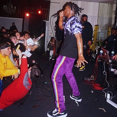 "Unotheactivist was seen performing in ""Orlando"" purple velour track pant."