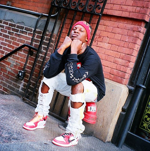 Bloody Dior in AJ1 x OFF WHITE sneakers. He is also wearing a Disco Inferno beanie, created by ASAP ILLz
