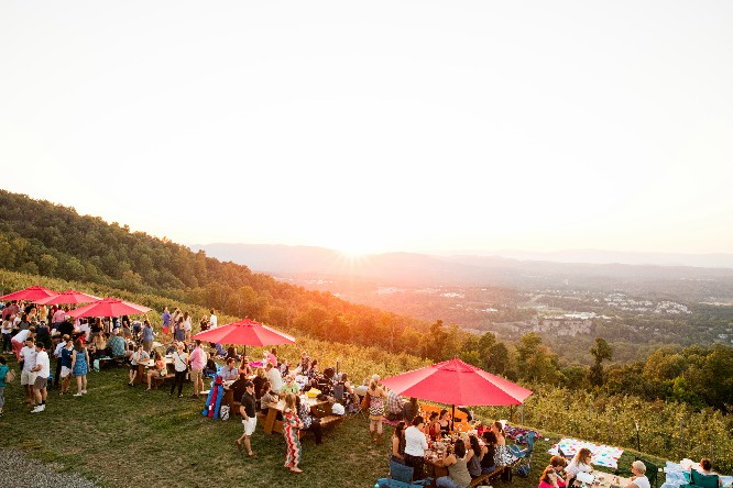 Revelers ogle a sunset at Carter Mountain. Hope you kept your eclipse glasses. Photo courtesy of content ChilesFamilyOrchard.com.