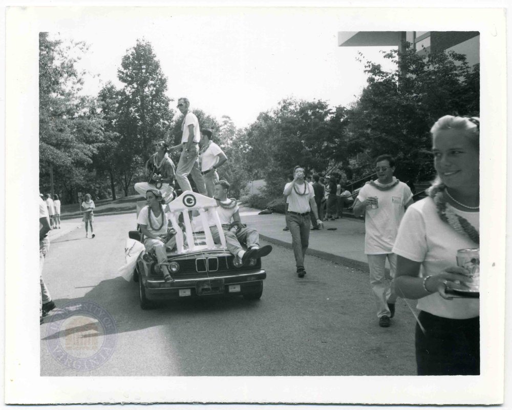 "1996 Section G rides atop a ""hand-made"" E30 BMW float at the Dandelion Parade. Photo courtesy of archives.law.virginia.edu."