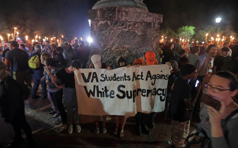 Tenacious UVa students circle the Thomas Jefferson statute on August 11, 2017. Photo courtesy of Daily Progress.