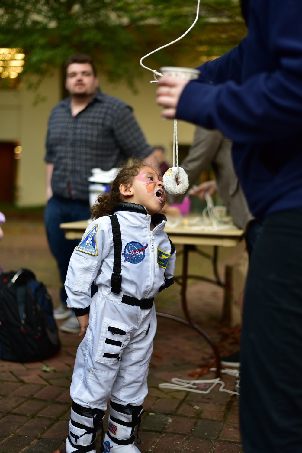 Cdr. Emma Ospina trains with a donut in anticipation of a zero gravity environment. Photo courtesy of Eric Hall.