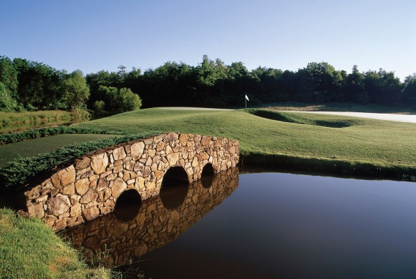 A lonely bridge extends accross a hazard at Birdwood Golf Course. Photo courtesy Virginia Golf Vacations.