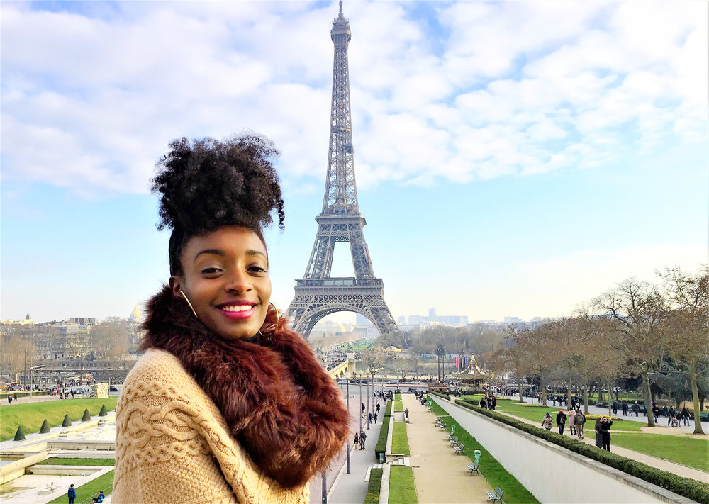 Briana Echols in front of the Eiffel Tower. Photo courtesy of Briana Echols.