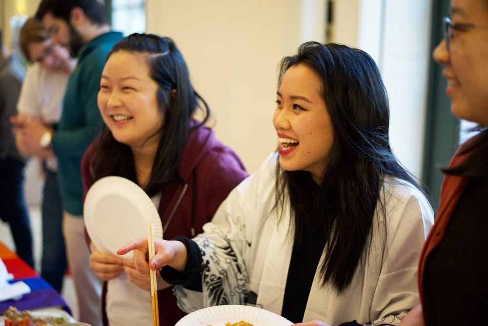 From left to right: Gina Sato '19 and Calla Zhou '19 serve fire ramen. Eric Hall/Virginia Law Weekly