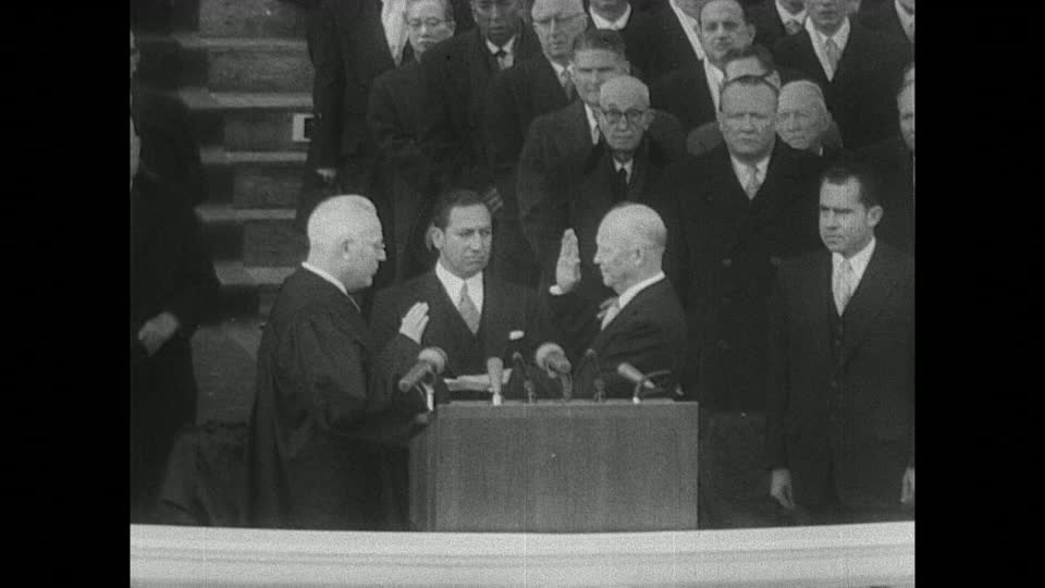 As then-Vice President Nixon looks on, Earl Warren administers President Eisenhower his second oath of office in 1957.  Photo courtesy Dwight D. Eisenhower Presidential Library.