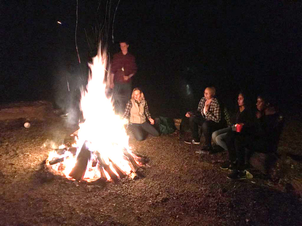 "3Ls gather around thier cozy mountain ""bonfire."" Photo Kim Hopkin / The Virginia Law Weekly"