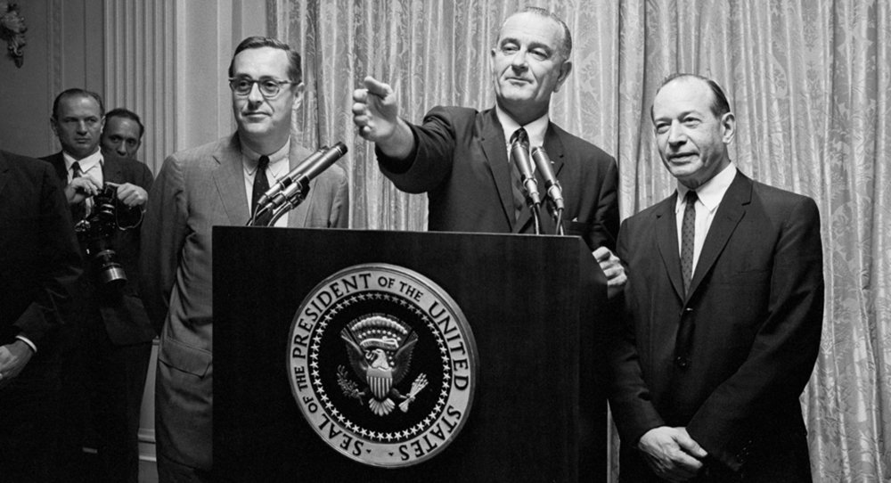 President Johnson takes questions at a press conference, flanked by Justice Fortas (right). Photo courtesy the AP.