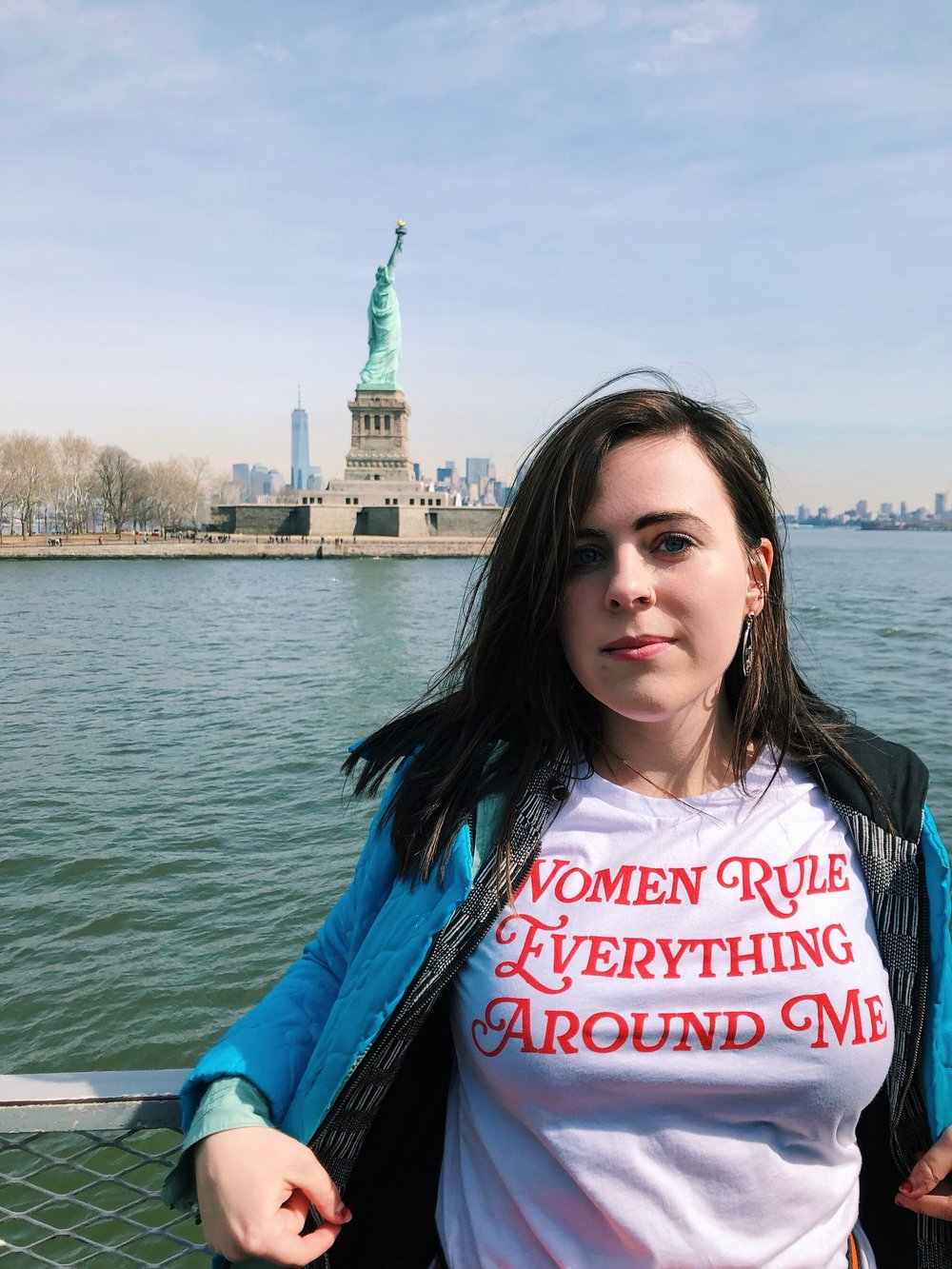 Kolleen Gladden '21 strikes a pose with fellow feminist Lady Liberty. Photo Credit César Andrés Sobrino Acuña