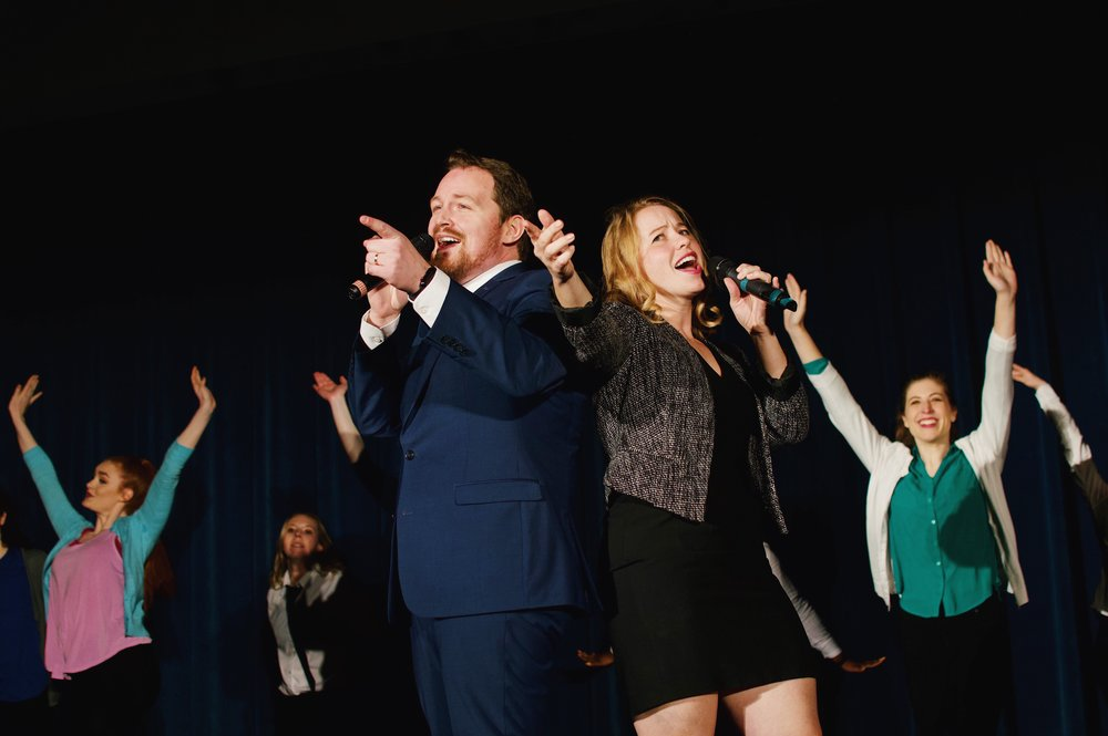 "William Kelly '21 and Caroline Kessler '19 sing about the relative merits of careers in Big Law and public interest in the song ""Big Law Til' I Die."" Photo credit Kolleen Gladden '21."
