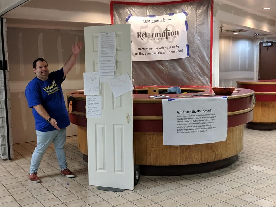 Our chaplain, advertising the door we used for our Reformation Day celebration tabling event.