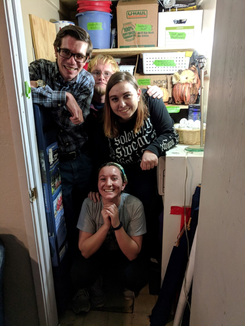 Some of our students, flaunting the closet that they organized.