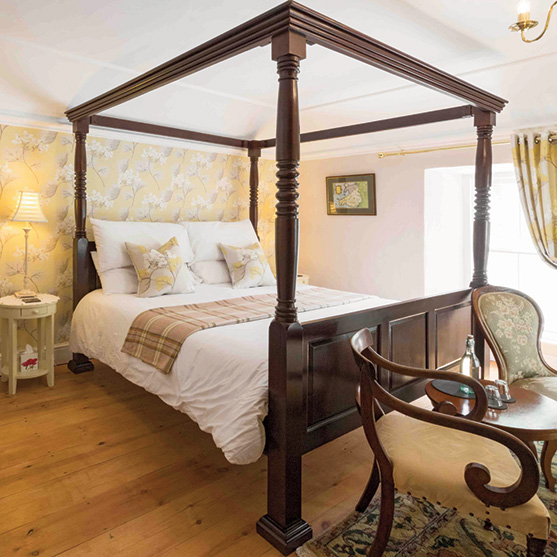 The stunning four poster super king bedroom.