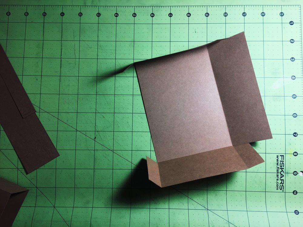 Making the box - measuring and cutting paper.