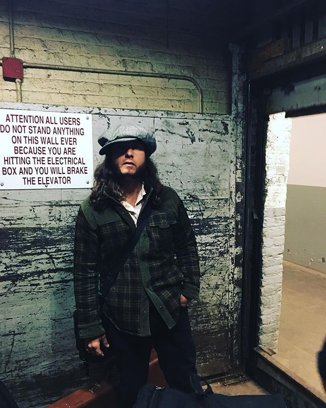 Fitz standing next to an exceptionally verbose sign c.2018 • • • No shows this weekend 😔, but we WILL be working on new original tunes and further plotting to take over the world 👀. Stay tuned—✌️✌️✌️