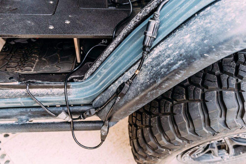 I added a splitter to allow the Snowmaster to run off of AC power when the Jeep is plugged in.