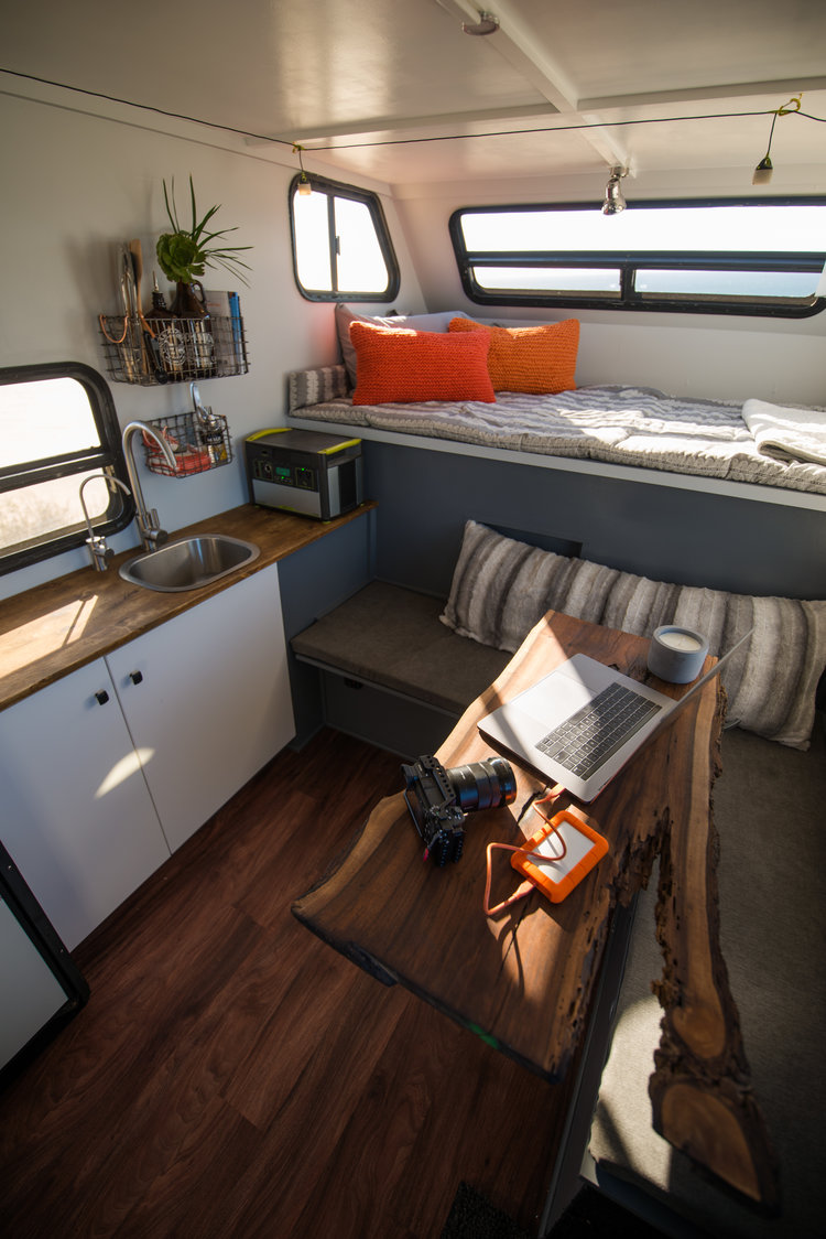 The living space looks more like a luxury tiny house than the typical expedition camper.