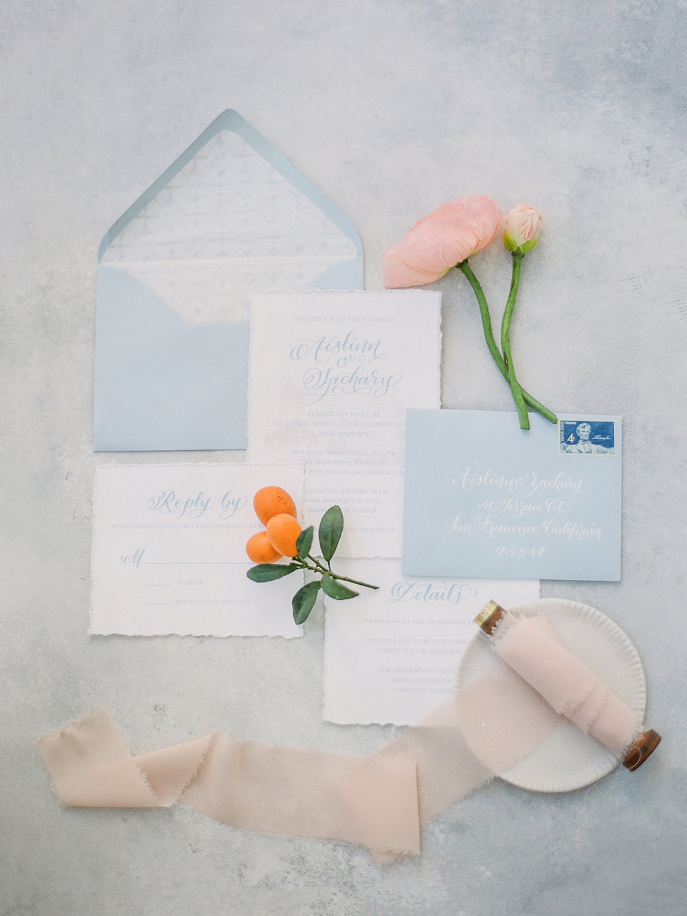Light blue and white wedding invitation