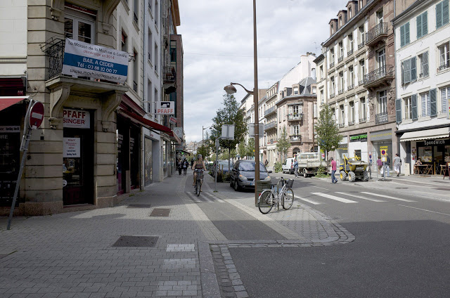 [Image:In some locations where where wider travel lanes are needed to accommodate bus stops, the separated bike lane is directed onto the street.]