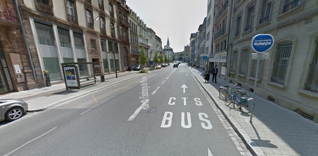 """[Image:Shared bus lane and bike lane, which is marked with  shared lane markings (""""sharrows"""") .]"""