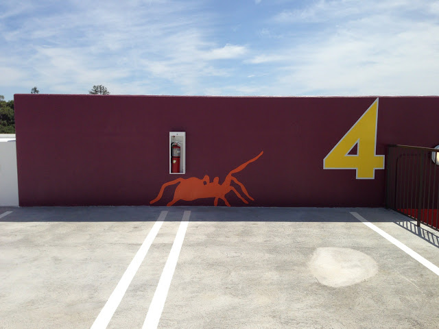 Signage adds colorful touches to the parking structure