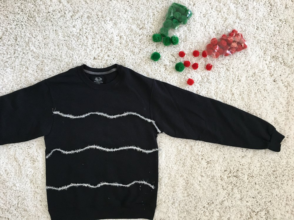 Black Christmas sweater with silver garland