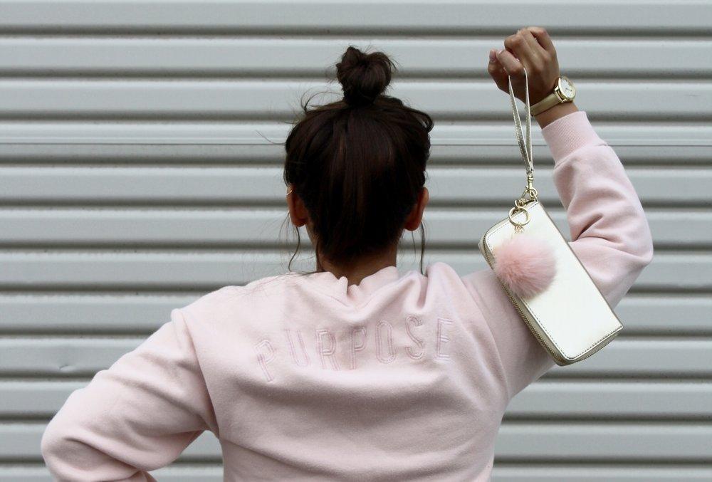 Top Knot Bun/ Blush Pink Purpose Sweatshirt/ Gold Clutch Wristlet with a pink pom pom keychain