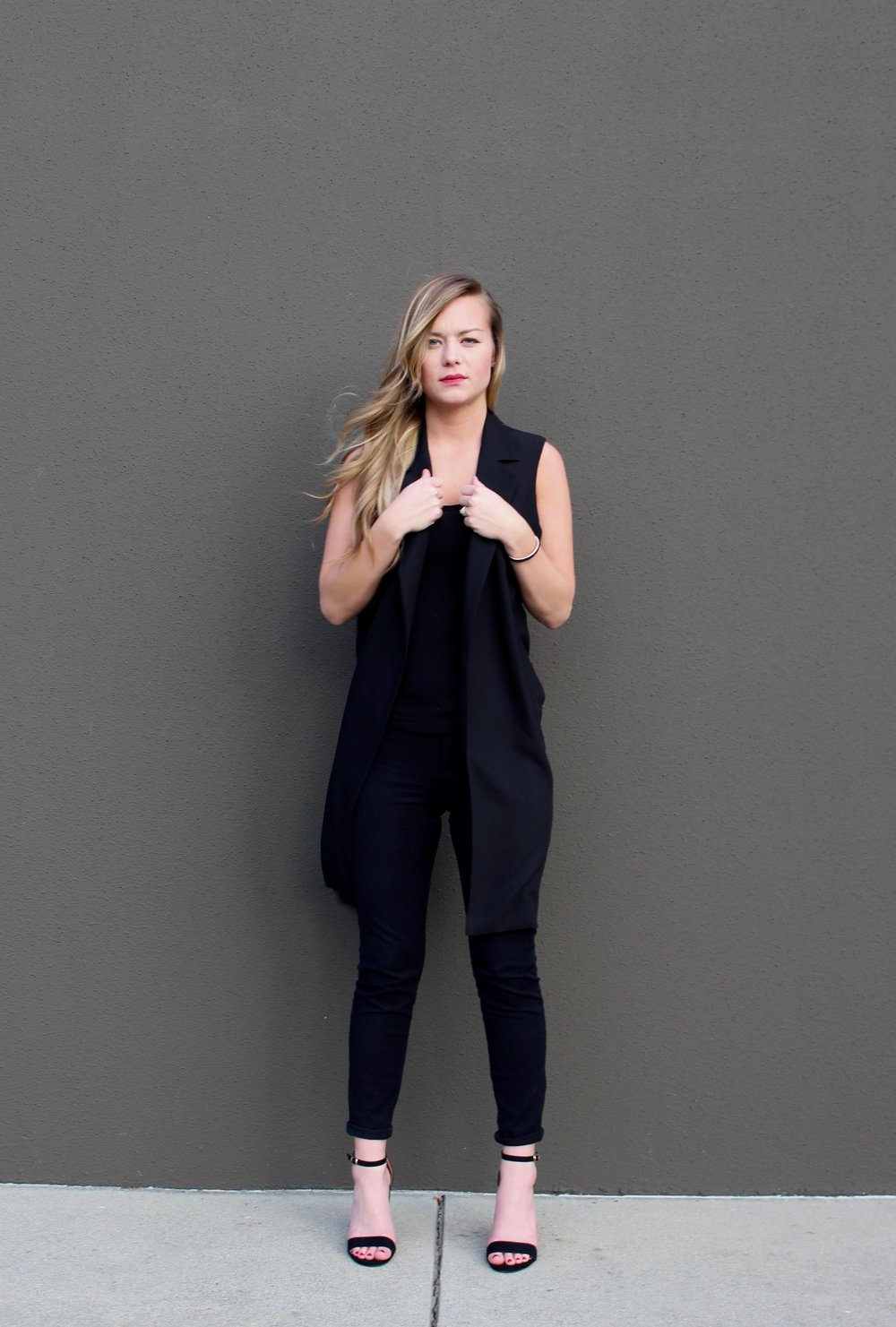 Sleeveless vest tailored pants and open toed heels