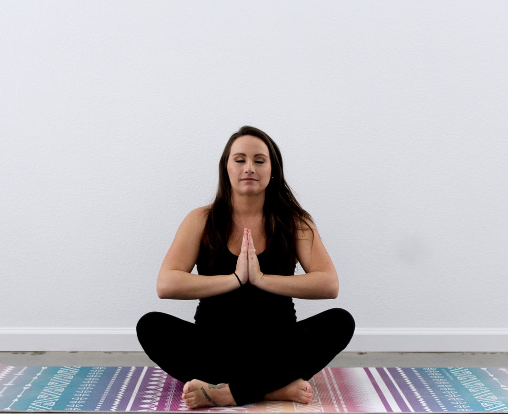 Namaste. Yoga instructor Michelle Trabucco