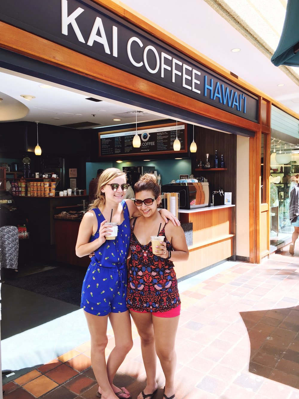 BFF's having Kai Coffee Lattes in Hawaii wearing tropical inspired clothing.