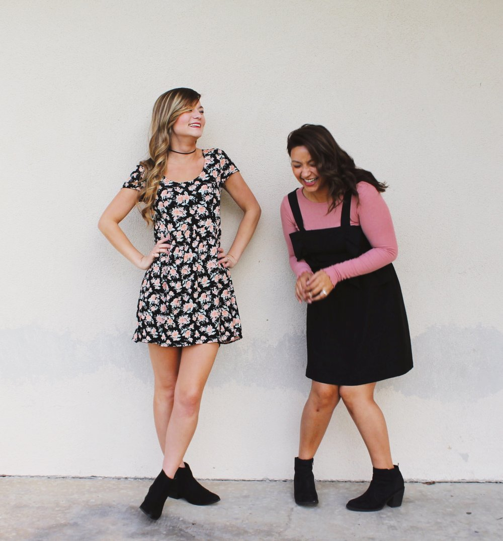 BFF's laughing. Black Ankle Boots. Floral 90's Inspired Lace Up Dress. Black Dress Jumper with Ruffle Details.