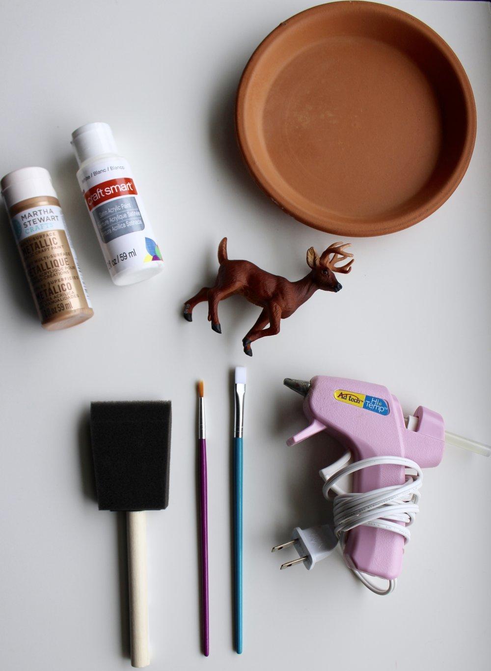 Materials to make a jewelry dish. Pink Glue Gun