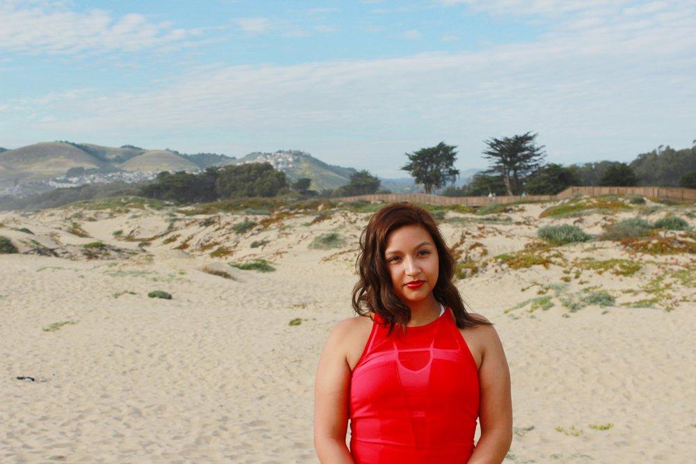 Pismo Beach Background. Red Express Dress with Halter Style Neckline.