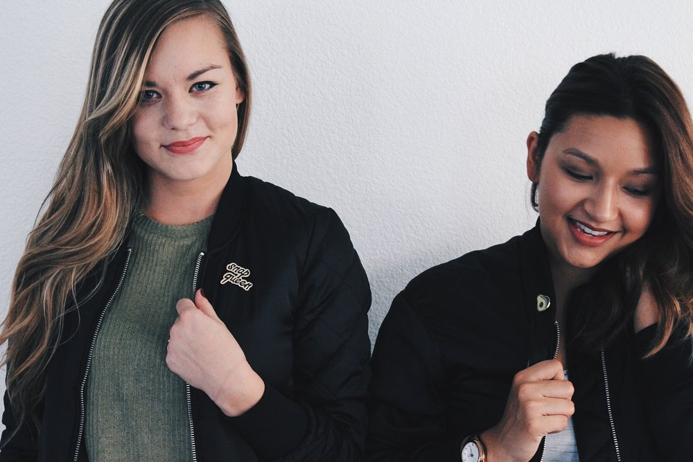 BFF Bloggers wearing Black Bombers and Pin Flair.