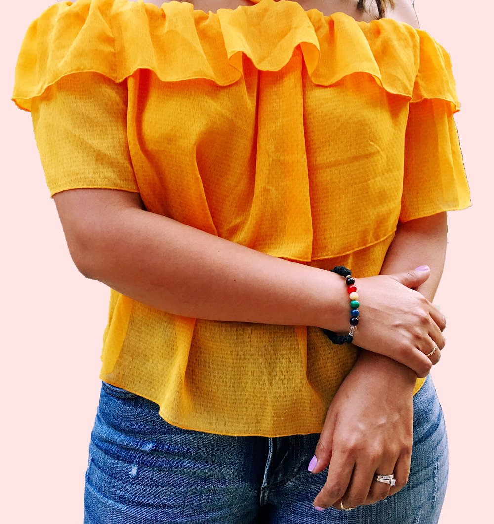 H&M Yellow Off the Shoulder Top with a 7 beaded Chakra bracelet with lava porous beads by Sunshine Warrior Gina DeRoos.