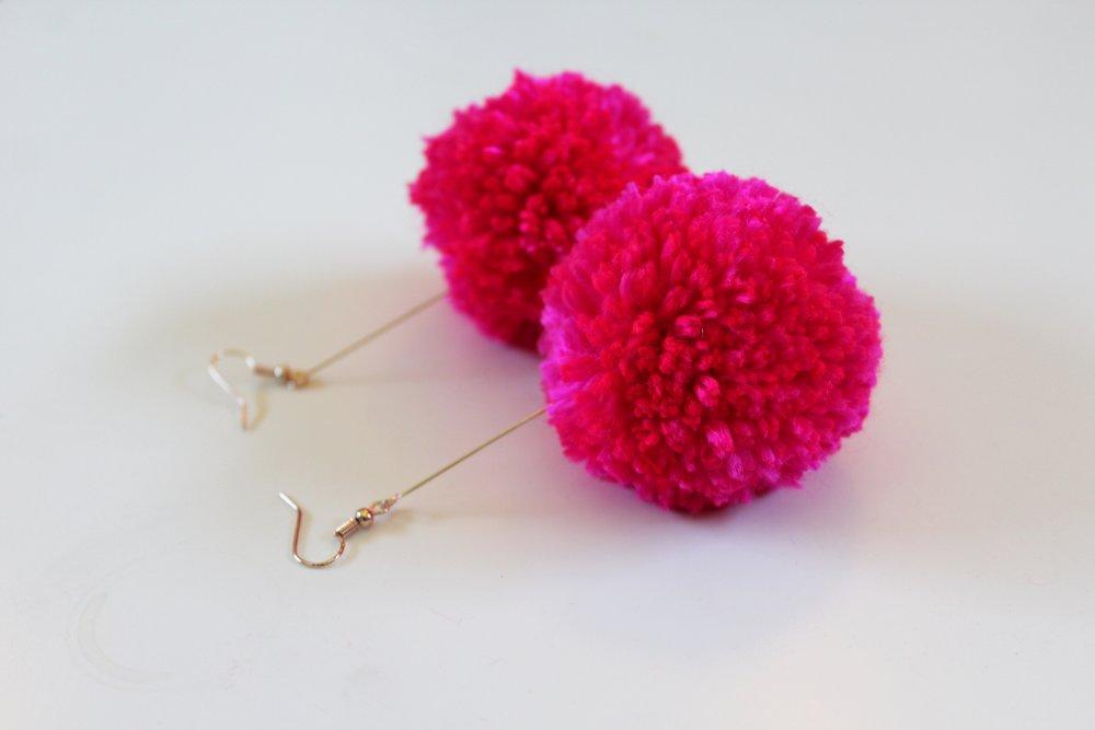 Hot Pink Pom Pom Dangle Earrings made with a Clover Pom Pom Maker.