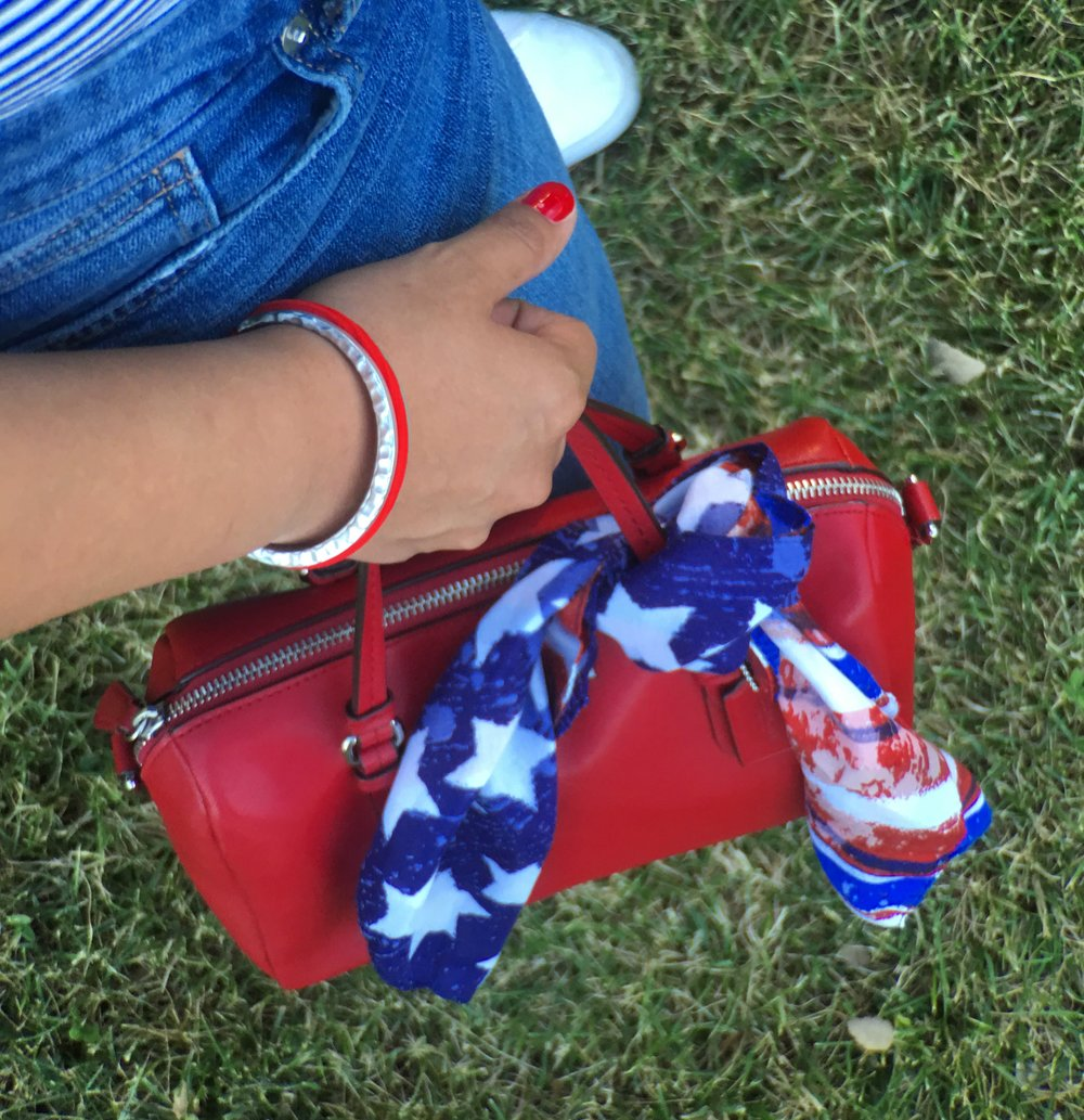 Red Coach Handbag with American Flag Scarf Detail and a Maria Shireen Silver Artisan HairTie Bracelet.