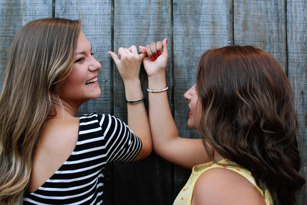 A pinky promise between BFF's.