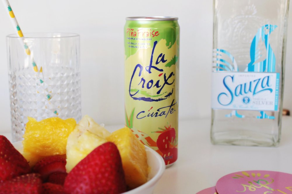 Pineapple Strawberry Flavored LaCroix Sparking Water with Tequila Cocktail.