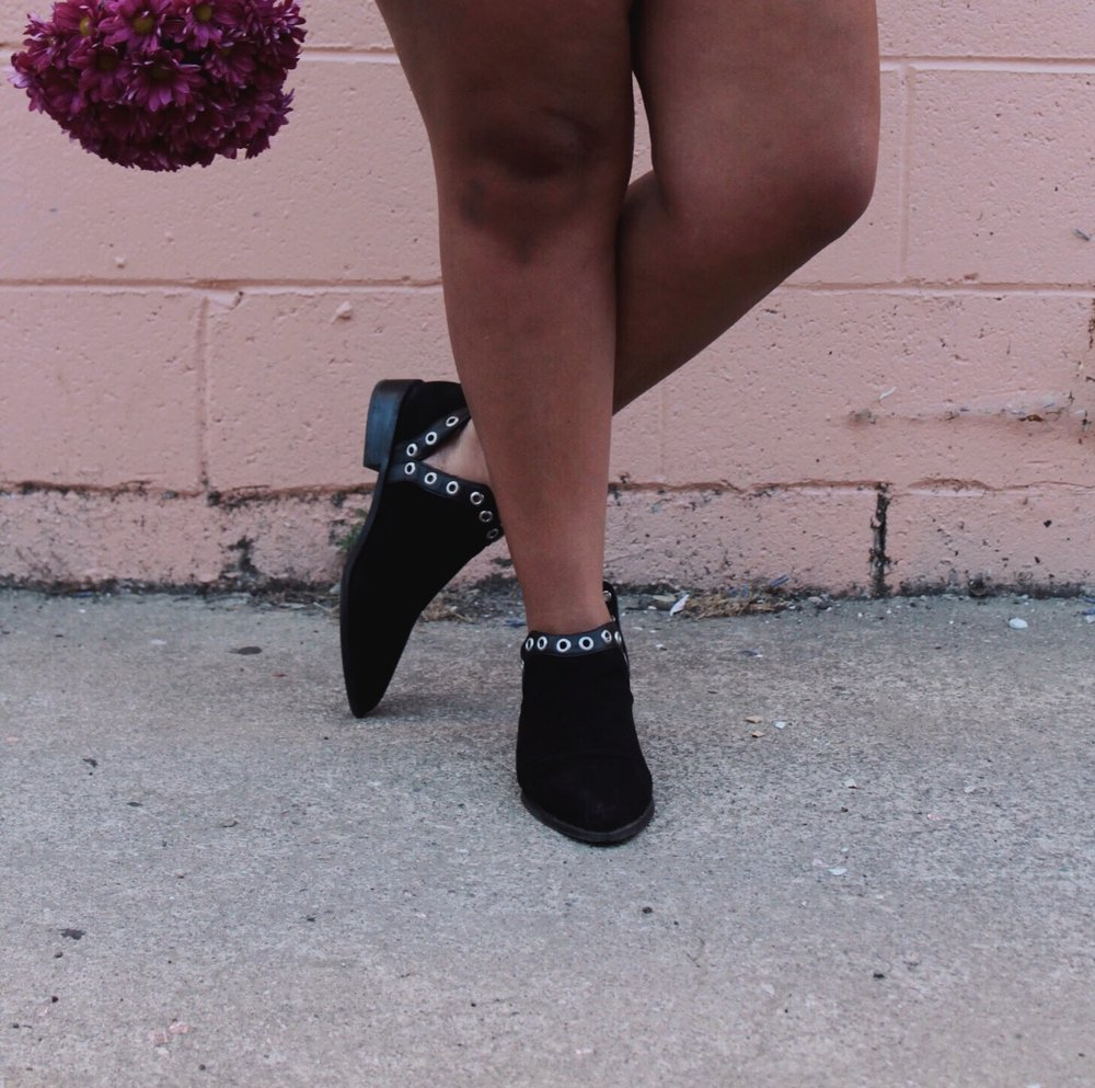 Black Ankle Boots with Eyelet Details and Purple Carnations.