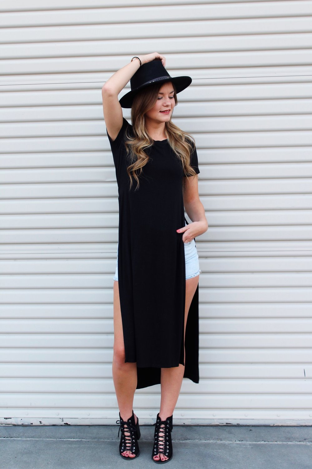 Tee Shirt Dress with Lace Up Heels and A wide brim black fedora hat.
