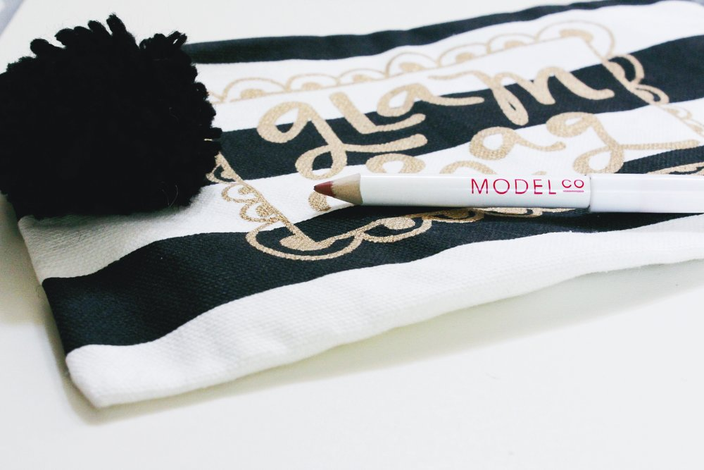 Model Co Lip liner with a glam bag make up pouch and pom pom