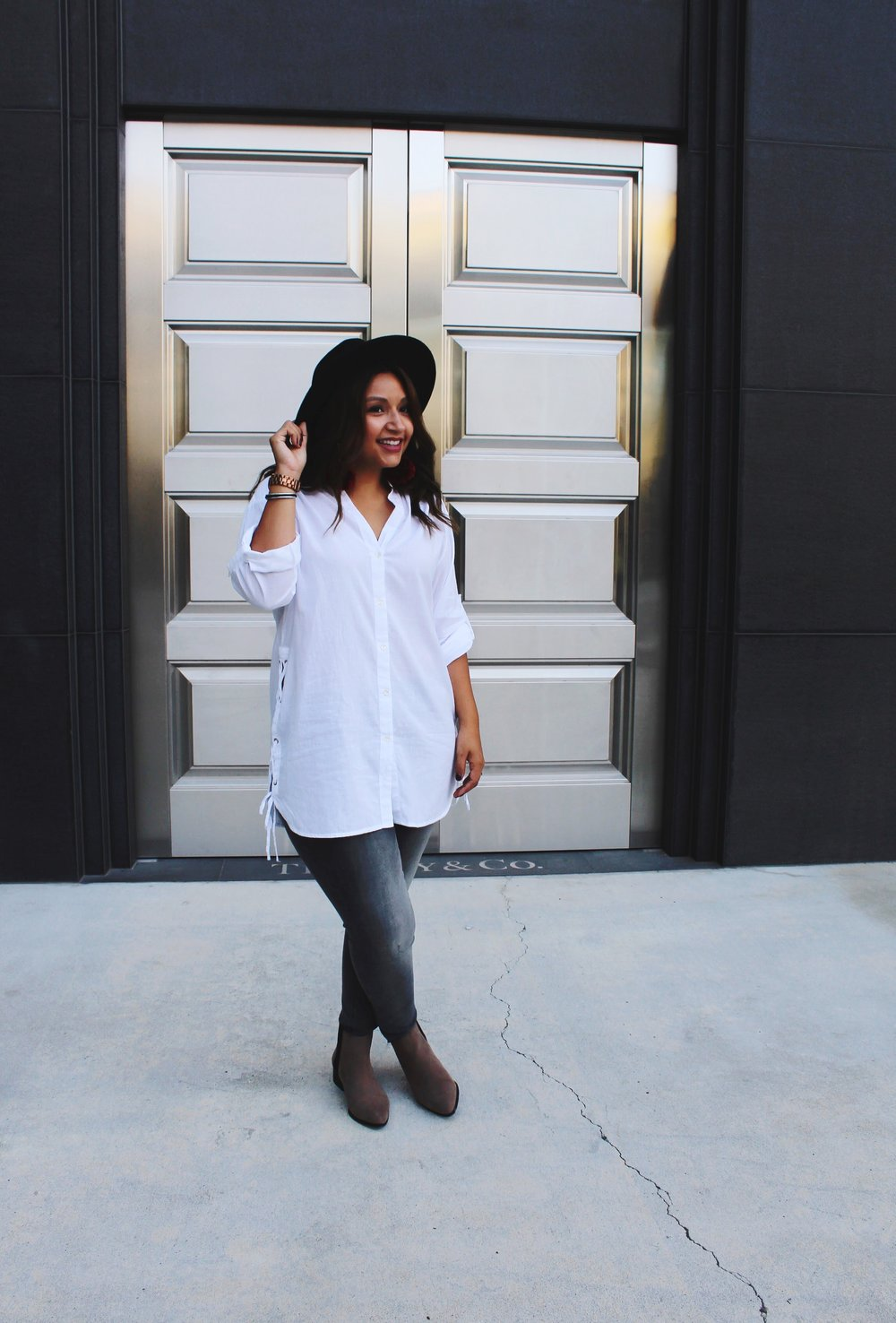 Silver Doors/ White Cotton Zara Button Down Shirt paired with a light grey wash express jeans and camel colored ankle boots