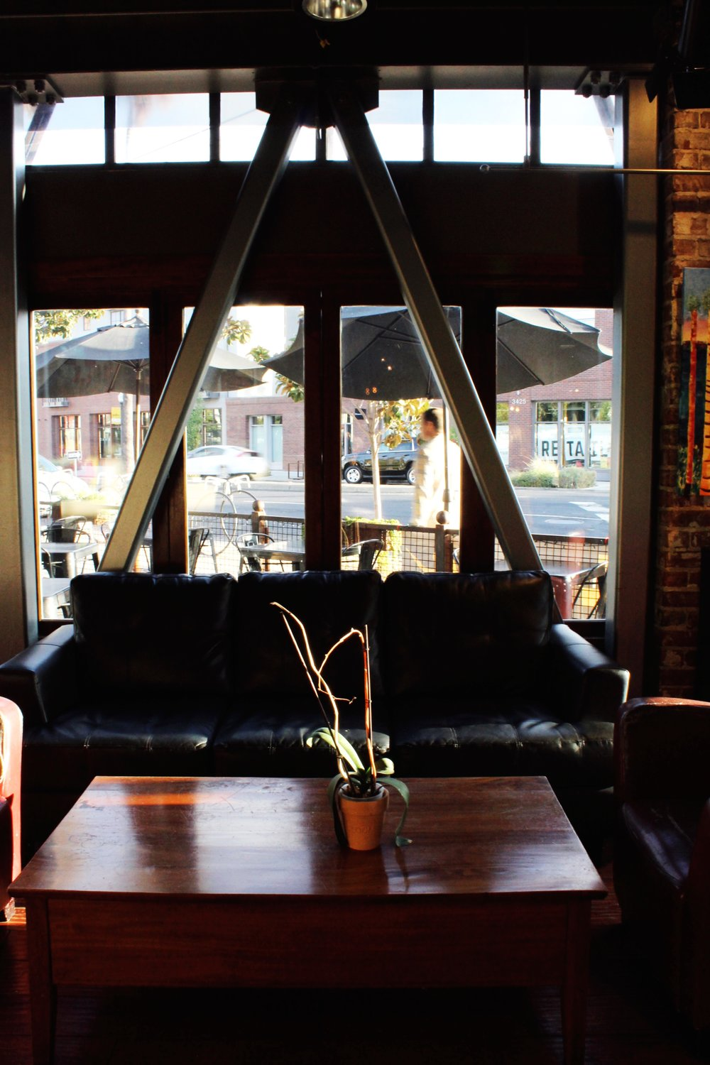Triangle window pane/ leather couch/ cozy nook at old soul coffee in oak park sacramento California